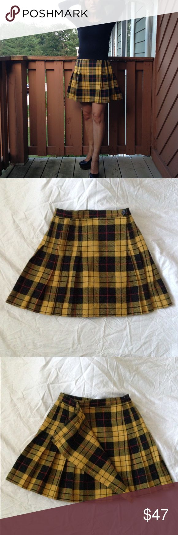 NAF NAF Tartan Wool Blend A-Line Skirt NAF NAF Tartan Wool Blend A-Line Skirt, in good used condition. Black, red and yellow keep this 30% wool and 70% polyester Naf Naf bright and classy. Versatile tartan plaid fabric is perfect for work and play. Two button closure and waist pleats for a flattering fit. Pair with a leather jacket and over the knee boots. The French size 38 fits a XS US size (waist: 12.25 inches across laying flat [waist: 24.5 inches] and length: 16.5 inches). NAF NAF…