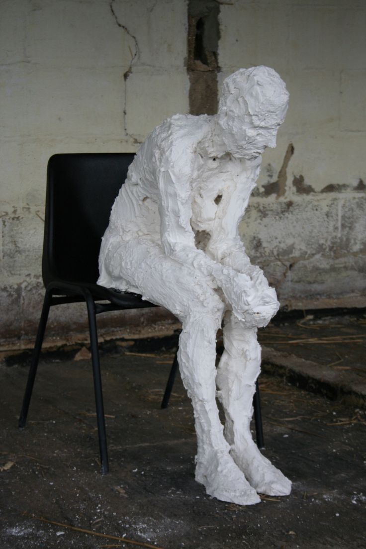 Chair 01: life-size plaster figure on a plastic chair