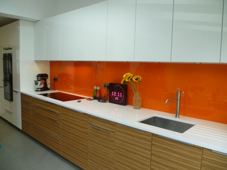 Gorgeous orange glass splash back www.shandlerhomes.co.uk