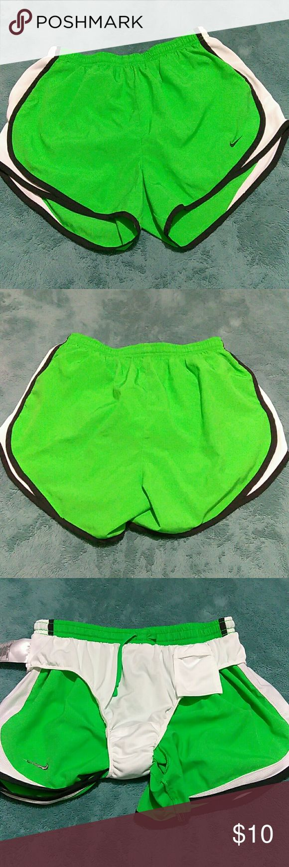Nike Shorts Nike fit dry shorts size small(4-6),with little pocket on inside in front with adjustable drawstring,lime green with black and white on sides ,from waist to bottom measures about 13inches long Nike Shorts