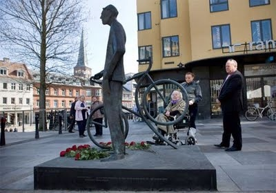 """Statue of Bernhardt Jensen, former mayor of Denmark's second-largest city, Aarhus. Artist: Jan Balling and the title is """"Time, The City and The Man"""". The mayor loved his bicycle and when he came into office in 1958 he did away with the official mayoral car."""