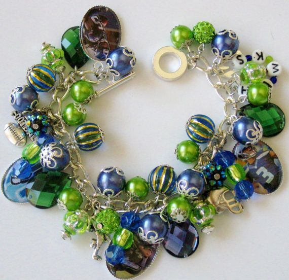 Hey, I found this really awesome Etsy listing at https://www.etsy.com/listing/201553650/sale-seattle-seahawks-charm-bracelet-fan