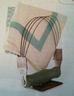 """DIY Napkin Holder via BHG 100 Ideas Flea Market Style Magazine """"-Whip up a napkin holder with vintage verve using a pastry cutter. To help the cutter stand on its own, screw the handle of the cutter to a base, such as a spare switchplate."""""""