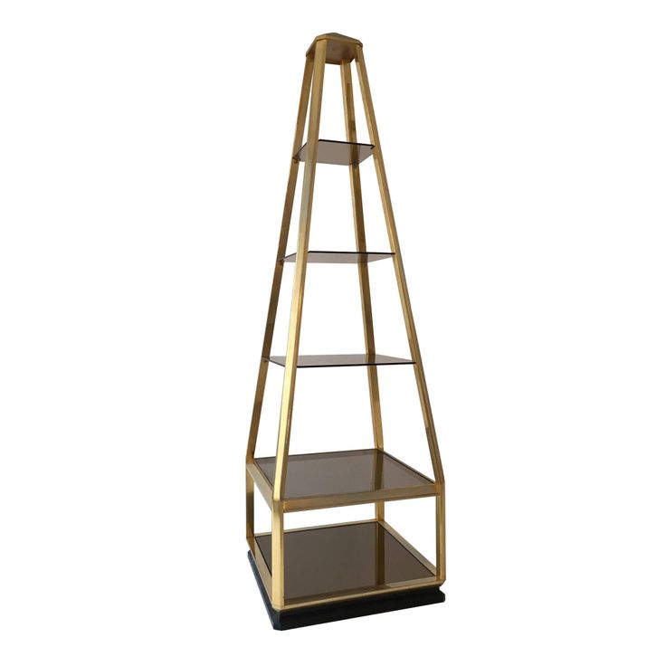 Circa 1970  This unique vintage display unit in style of Milo Baughman features a pyramid shaped fixture housing four smoked glass shelves and a mirror base.  SIZE  Width: 55 cm Depth: 56.5 cm Height: 187 cm  STOCK 1 Available