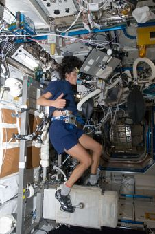 NASA astronaut Sunita Williams, Expedition 32 flight engineer, performs a VO2max test while using the Cycle Ergometer with Vibra