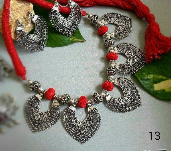 Red thread oxidised german silver 5 leaf pendant and leaf earring