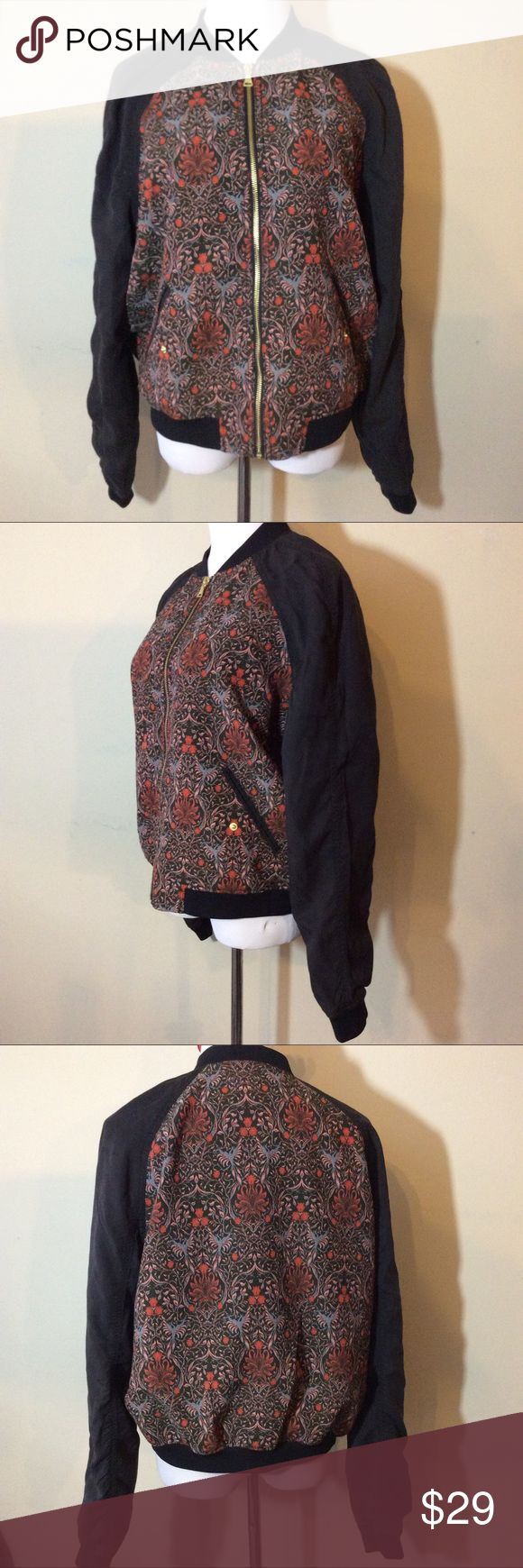 "EXPRESS Black Floral Print Bomber Jacket Medium Make this yours! New without tag EXPRESS Women's Black Floral Zip-up Bomber Jacket. Great for Spring!  The Measurements: Tag Size: Medium Chest: 44"" Length: 22""   Condition: No signs of wear Express Jackets & Coats"