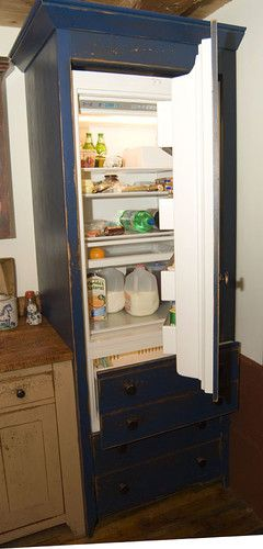 How to hide modern appliances in a reproduction from the for Reproduction kitchen cabinets