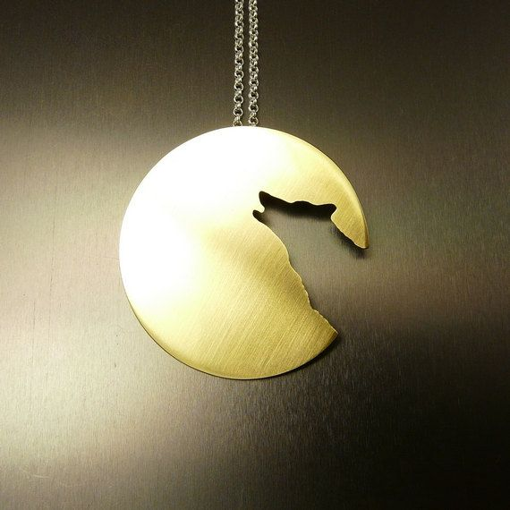 Lone Wolf  : smaller version brass pendant on a sterling silver chain. $35,00, via Etsy.