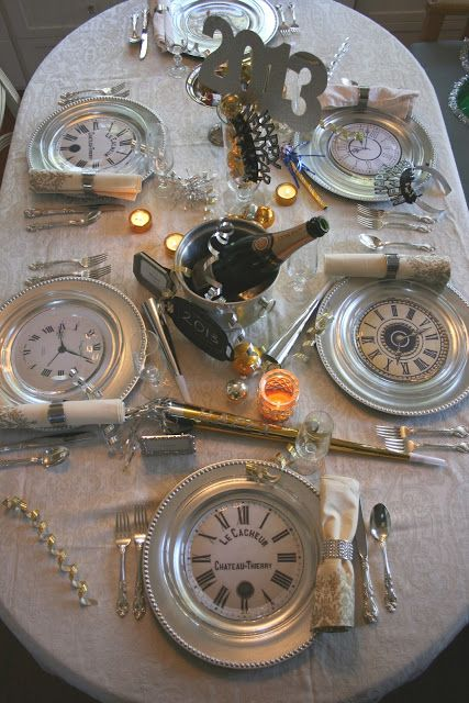 EASY DIY Silver chargers and glass plates have  clock faces nestled between them.
