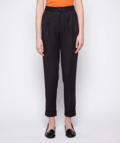 Front pleat trousers crafted in a winter weight wool blend fabric with a hint of elastane. Cut with a high waist and turn up detail for a 7/8 length, details include two curved pockets, a concealed zip fastening and decorative three button detail on the s