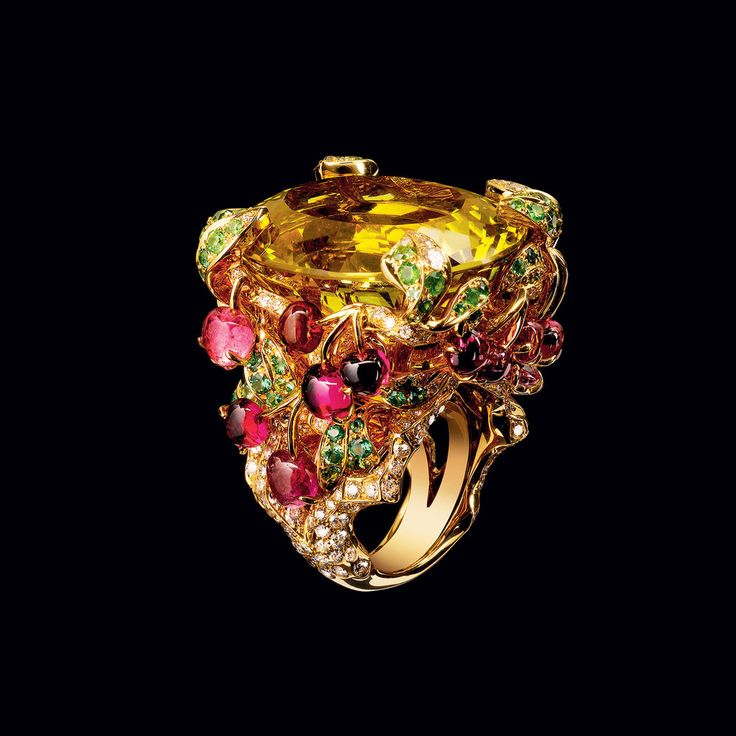 """from 'Dior Joaillarie' by Michèle Heuzé, a Dior ring called """"Incroyables et Merveilleuses Cerise"""" (Fr., trns: Cherry, from the Dior Incredible and Marvelous Collection) - looks like a citrine, with multi-colored tourmalines, or ruby & emeralds, & diamonds, set in yellow gold."""