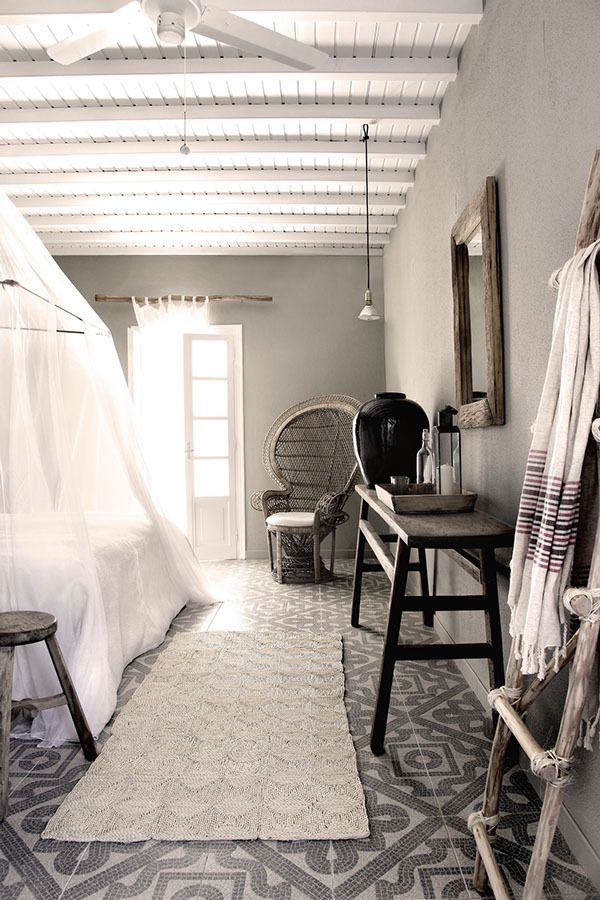 Peacock chair, neutral black, white, grey, brown color scheme, gorgeous natural lighting, ladder for towels and throws...love!