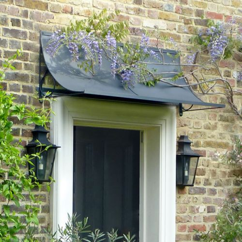Pretty wisteria trailing across a deep scoop steel door canopy //. & 54 best Metal Door Canopies images on Pinterest | Canopies ...