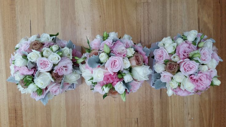 PINK PERFECTION! wedding bouquets made with fresh flowers in a few different shades of pink. Roses, lisianthus, silver suede, mini roses and foliage.