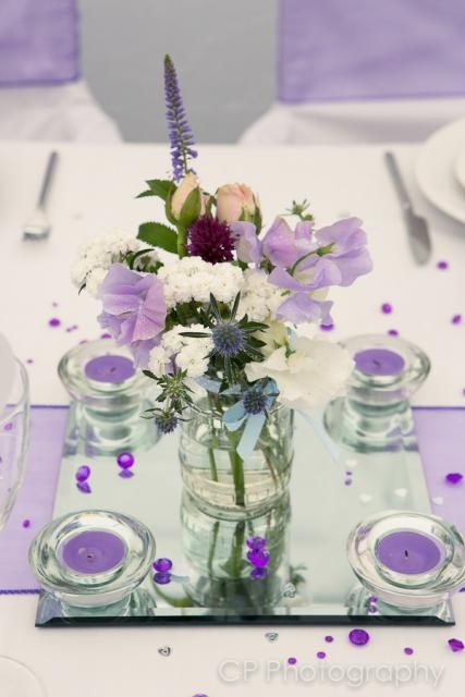 Vintage floral arrangements by the White Horse Flower Company, look stunning with Fuschia's violet accessories by www.fuschiadesigns.co.uk.