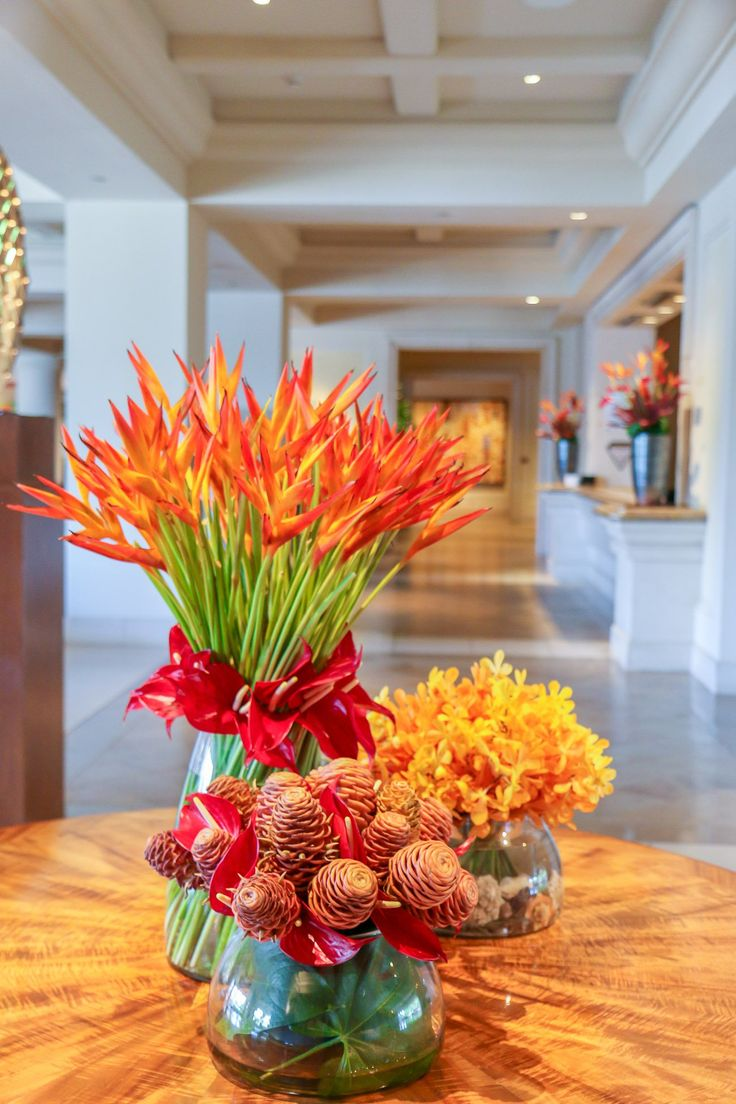 A group of tropical flower arrangements at