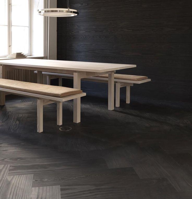 Grandpattern herringbone flooring in Dinesen showroom, Copenhagen. Solid Dinesen Douglas planks with a black oil finish.