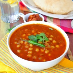 Chana masala with soft, fluffy deep fried Indian bread.