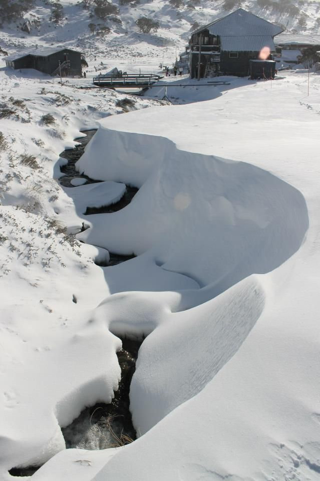 Snow Australia - snow covered stream at Charlotte Pass ski resort in New South Wales #snowaus