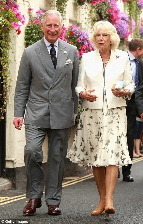 A smiling Charles and his wife the Duchess of Cornwall ignored the drizzle as they met crowds in Padstow, Cornwall at the start their three-day tour of the West Country.
