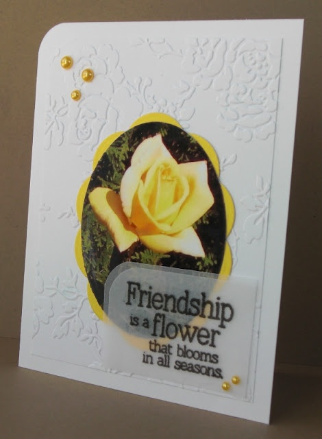 handmade card ... photo as focal point ... yellow rose photo cut into oval shape and matted with big scallop oval .. luv the double layer of vellum that makes a base for the sentiment ... great card!!