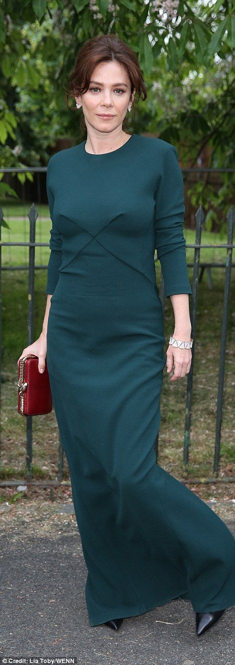 Jewel hues: Anna Friel looked lovely as ever in a figure-hugging green gown with a slit of...