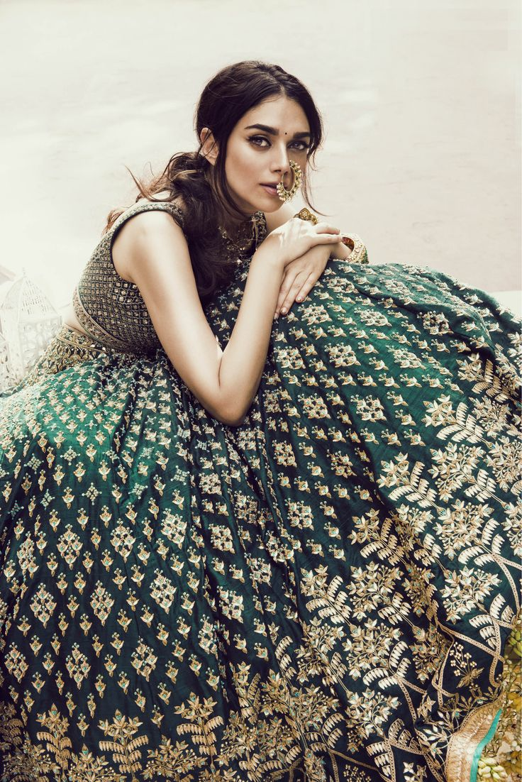 Toying with the idea of wearing a deep green lehenga for my wedding day.