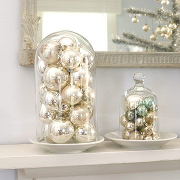 Have a Ball  Top the mantel with a display of ball ornaments. Fill a glass cloche with a mass of similar orbs, or mix it up with a variety of shapes, sizes, and colors. Set a plate upside down on the opening of the filled cloche, turn it over, and place it on the mantel.