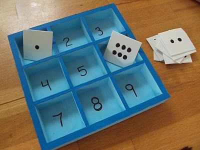 write numbers in a dollar store sectioned box, use for any type of activity involving numbers or counting...dollar store beads or pebbles would be good to count out