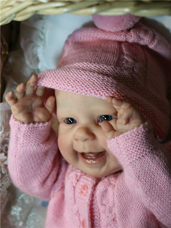 This is a really happy looking babydoll. They truly captured the happiness of a real baby