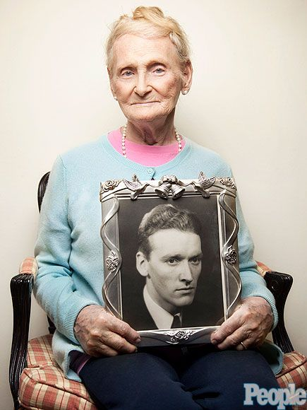 WWII Veteran Who's Now a Woman Wins a Legal Battle for Transgender Couples. Pictured here is Robina Asti, 92, with a photo of her late husband Norwood.