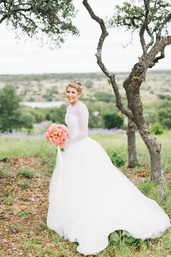Ashley's gown was so unique and timeless! Hear more about her big day on the blog!