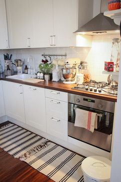 Again love cabinet, floor, counter combo. Also like the cup hanger for often used things.