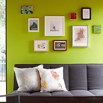Provide a common denominator  Diverse mediums and frames are brought to together by a single, shared wall color.