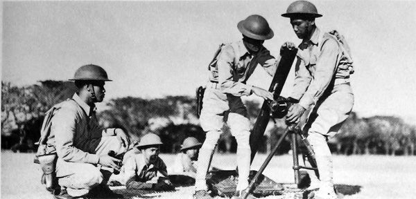 MORTAR SQUAD ASSEMBLING AN 81-MM. MORTAR MI during training in the Philippine Islands in 1941. In 1936 a program for national defense was initiated in the Philippine Islands. A military mission of U.S. officers was charged with the organization and training of Filipino regular troops. In July 1941 the Philippine Army was ordered into the service of the Army of the United States and U.S. troops were sent to the islands from the United States.