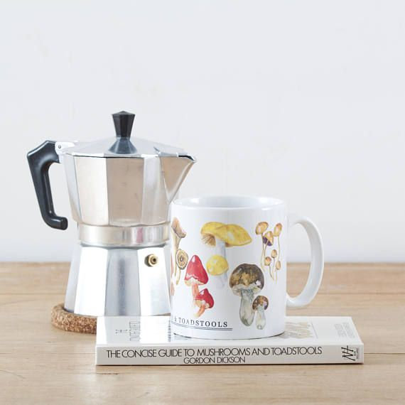 A lovely ceramic mug printed with illustrations of British Mushrooms & Toadstools. Inspired by vintage observers book educational prints, this quirky printed mug will add a touch of nostalgia to your home. The mug features original watercolour illustrations by artist Eleanor