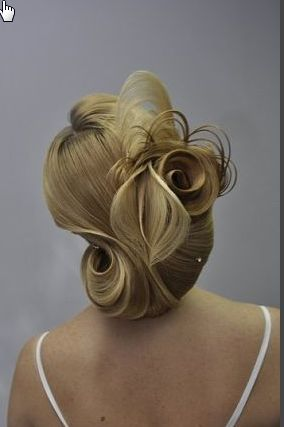 How in the world do they do hair like this?? Beautiful but honestly it doesn't look real!