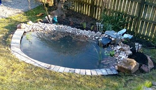 Pond edging done, just need some larger feature stones to break up the water