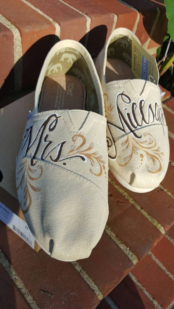 Custom hand painted wedding Toms. Perfect way to personalize your shoes on your special day. These Toms are the natural canvas color with an iridescent sparkle coat added. The details, colors and font can all be changed to match your color scheme and theme. Please feel free to let me know if you have any questions