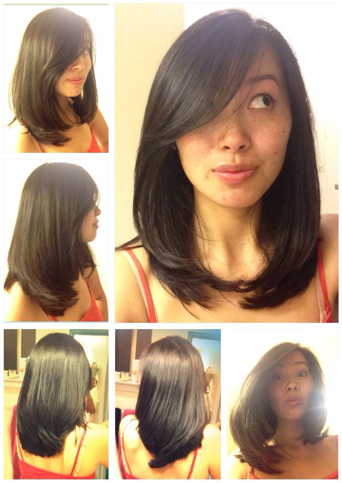 Layered straight medium length asian hair side swept bangs fun and cute hair style