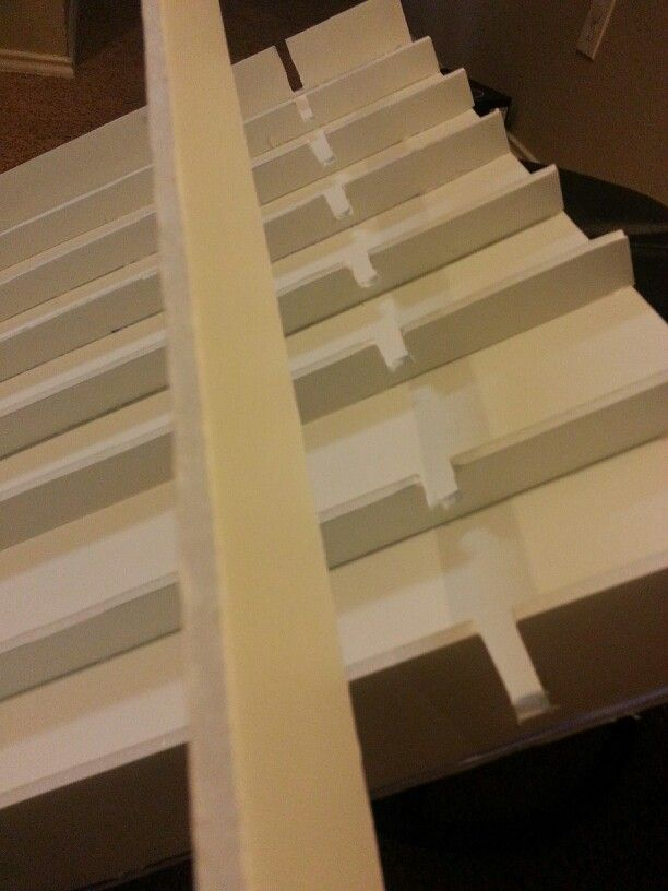 cut out some pieces so you can place the form board horizontally.  so multiple cars can start at the same time DIY homemade race track ramp