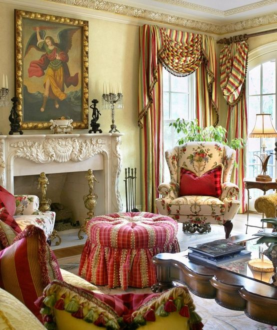Living room by Joy Tribout. Fabrics echo the exquisite reds and yellows in the oil painting.