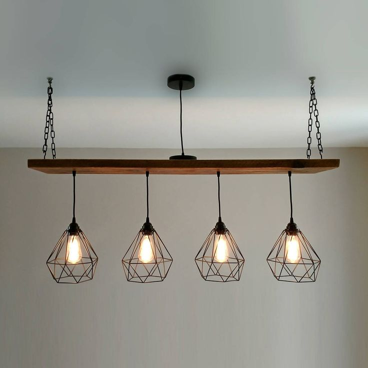I've just found Solid Wood Beam Multi Industrial Light Oak Style. An industrial feature style light that suspends four cage lights. Ideal for above a dining table or as a centre piece in a room.. £345.00