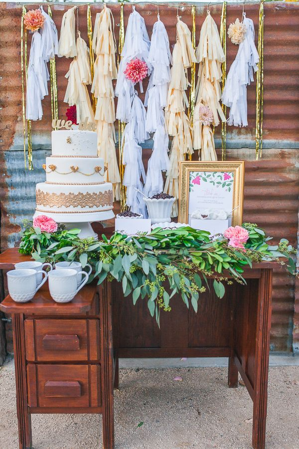 cake table with gold and tassel backdrop #caketable #diy #weddingchicks http://www.weddingchicks.com/2014/02/17/feel-good-floral-wedding-ideas/