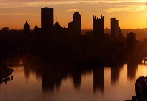 The Pittsburgh skyline reflects in waters at the Point.