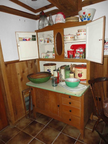 Antique Hoosier Cabinet Enamel Counter Top. I am thinking...I have always wanted one but no room in the Cottage kitchen...find one with wood countertop, sort of shabby shape, and make into dresser somehow, maybe find just the bottom...hm...