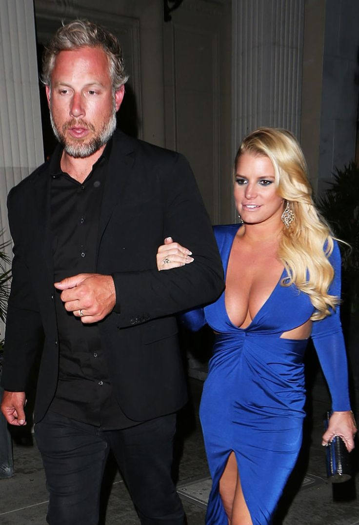 Jessica Simpson showed off an eye-popping display of cleavage in a plunging blue dress on a date night with husband Eric Johnson on Saturday, May 14 — read more