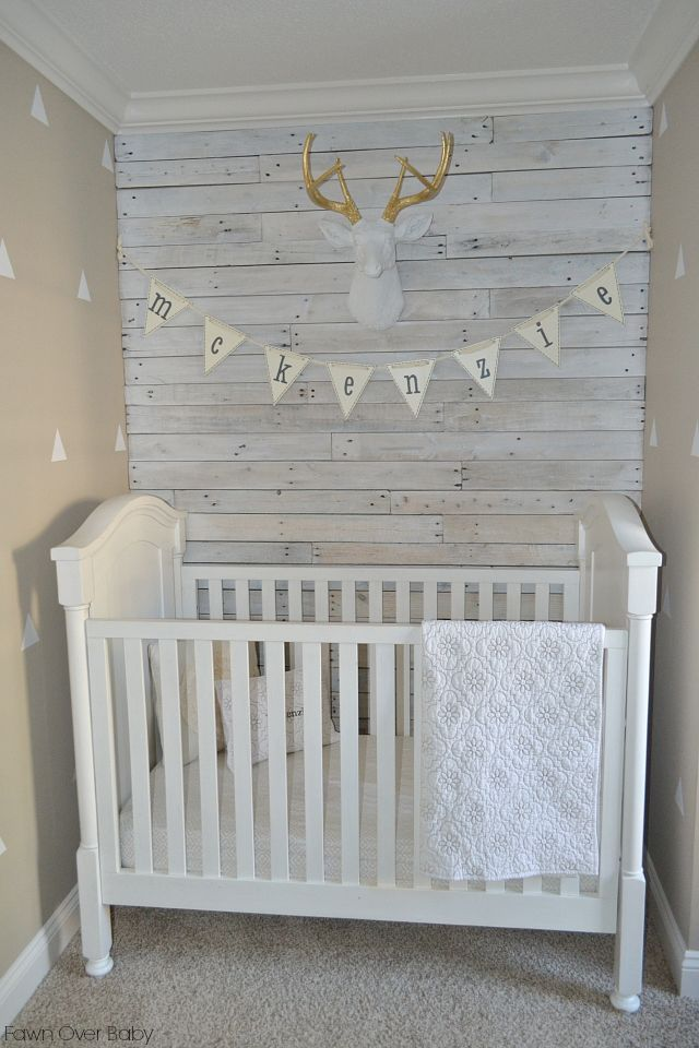 This white-washed wood pallet accent wall is such a fun touch to this rustic nursery!