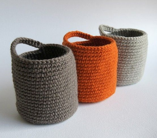 crochet storage baskets to hang at entryway for loose gloves, scarves, etc. from etsy= would love to learn how to actually do these! by judith